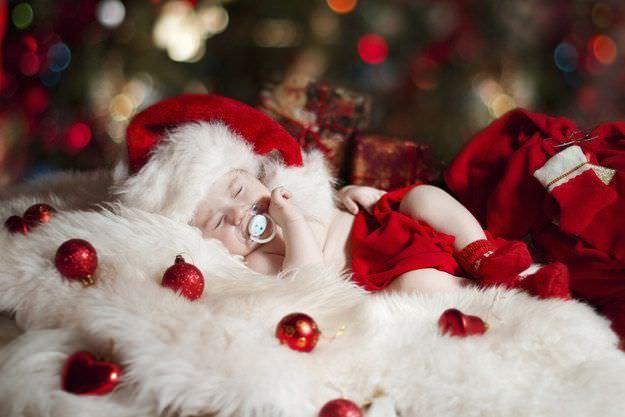 Fotografías de bebés que disfrutan a lo grande en Navidad 5