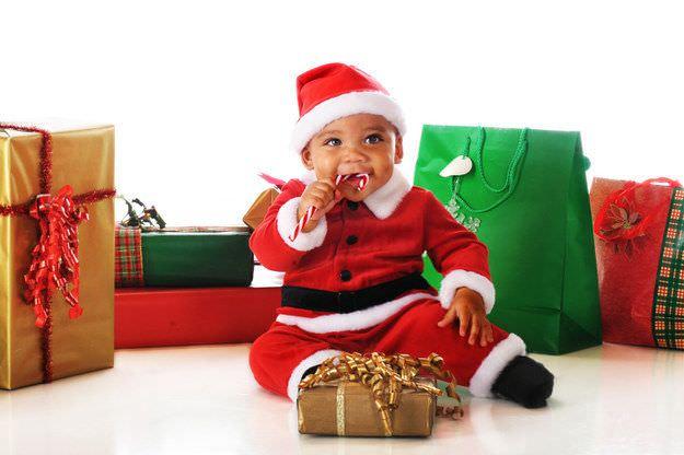 Fotografías de bebés que disfrutan a lo grande en Navidad 9