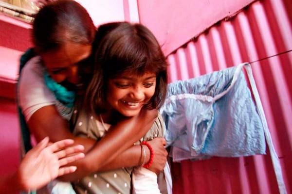 Padres y sus hijos en diferentes países del mundo-India